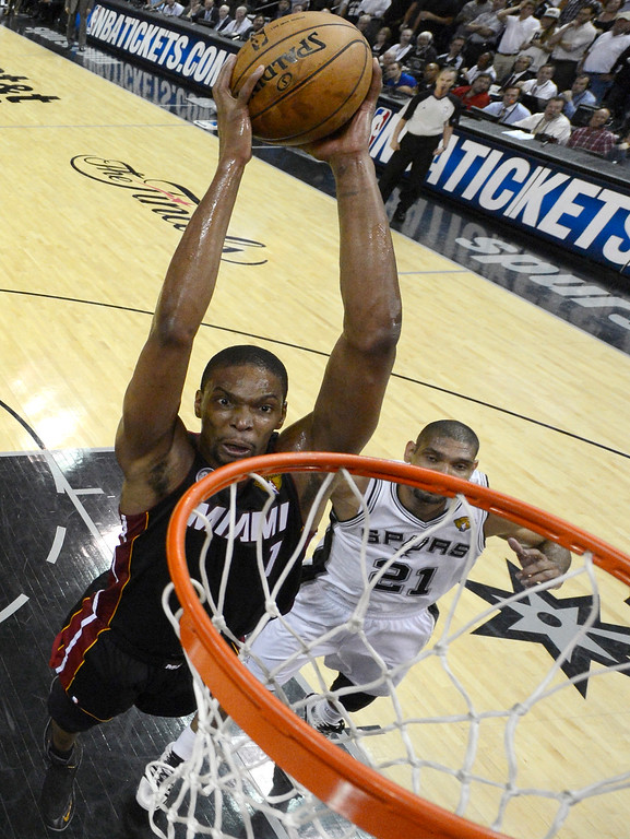 . Miami Heat\'s Chris Bosh (1) dunks against the San Antonio Spurs during the first half at Game 4 of the NBA Finals basketball series, Thursday, June 13, 2013, in San Antonio. (AP Photo/Derick E. Hingle, Pool)