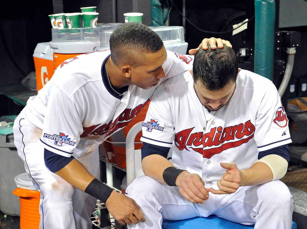 . Cleveland Indians\' Michael Brantley, left, consoles Jason Kipnis after the Tampa Bay Rays defeated the Indians 4-0 in the AL wild-card baseball game Wednesday, Oct. 2, 2013, in Cleveland. (AP Photo/Phil Long)