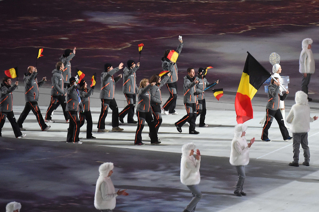 . Belgium\'s flag bearer, bobsledder Hanna Emilie Marien leads her national delegation during the Opening Ceremony of the Sochi Winter Olympics at the Fisht Olympic Stadium on February 7, 2014 in Sochi.     AFP PHOTO / DAMIEN MEYER/AFP/Getty Images