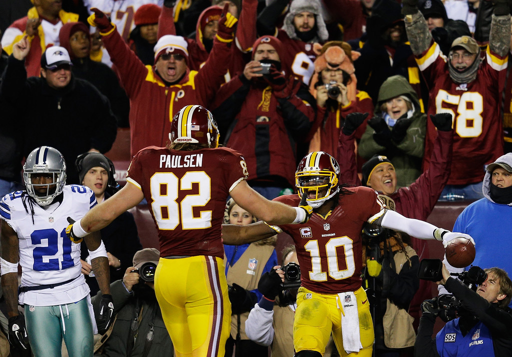 . LANDOVER, MD - DECEMBER 30:  Robert Griffin III #10 celebrates his third quarter touchdown against the Dallas Cowboys with Logan Paulsen #82 of the Washington Redskins at FedExField on December 30, 2012 in Landover, Maryland.  (Photo by Rob Carr/Getty Images)