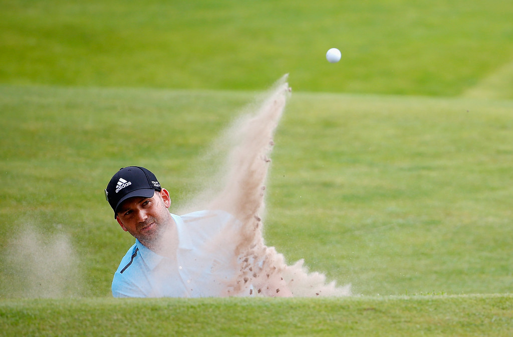 . Sergio Garcia of Spain plays his second bunker shot on the 15th hole during the final round of The 143rd Open Championship at Royal Liverpool on July 20, 2014 in Hoylake, England.  (Photo by Tom Pennington/Getty Images)