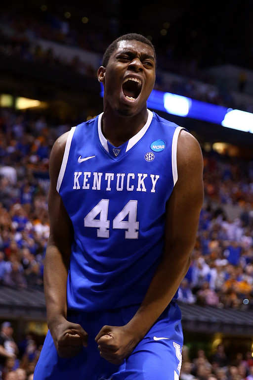 . Dakari Johnson #44 of the Kentucky Wildcats celebrates after making a basket in the first half against the Louisville Cardinals during the regional semifinal of the 2014 NCAA Men\'s Basketball Tournament at Lucas Oil Stadium on March 28, 2014 in Indianapolis, Indiana.  (Photo by Andy Lyons/Getty Images)