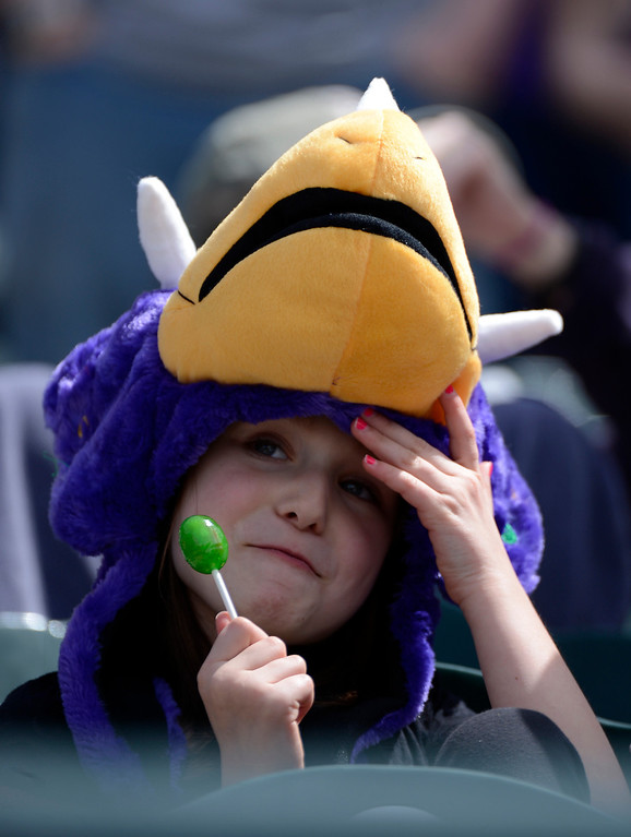. DENVER, CO. - APRIL 21: Marie Slotnick 9-years-old of Arvada wears her Dinger hat while enjoying her blow pop at the Colorado Rockies Arizona DiamondBacks game April 21, 2013 at Coors Field. (Photo By John Leyba/The Denver Post)
