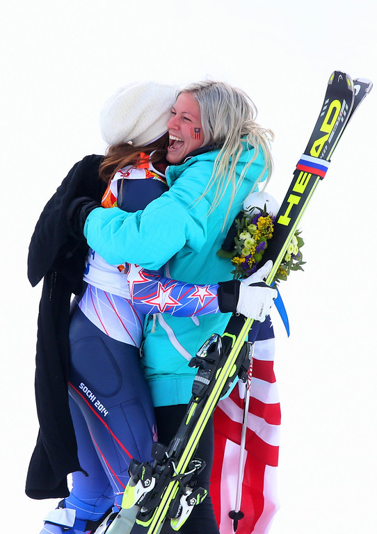 . Julia Mancuso of the United States celebrates her bronze medal with her sister Sara Mancuso (R) runs to celebrate during the flower ceremony in the Alpine Skiing Women\'s Super Combined Slalom on day 3 of the Sochi 2014 Winter Olympics at Rosa Khutor Alpine Center on February 10, 2014 in Sochi, Russia.  (Photo by Alexander Hassenstein/Getty Images)