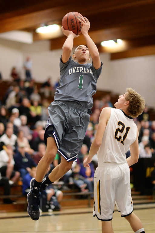 . CENTENNIAL, CO. JANUARY 18: Jarvae Robinson of Overland High School (1) aims basket over C.J. Bossart of Arapahoe High School (21) in the 2nd half of the game at Arapahoe High School. Centennial Colorado. January 18. 2014. Arapahoe won 62-54.  (Photo by Hyoung Chang/The Denver Post)