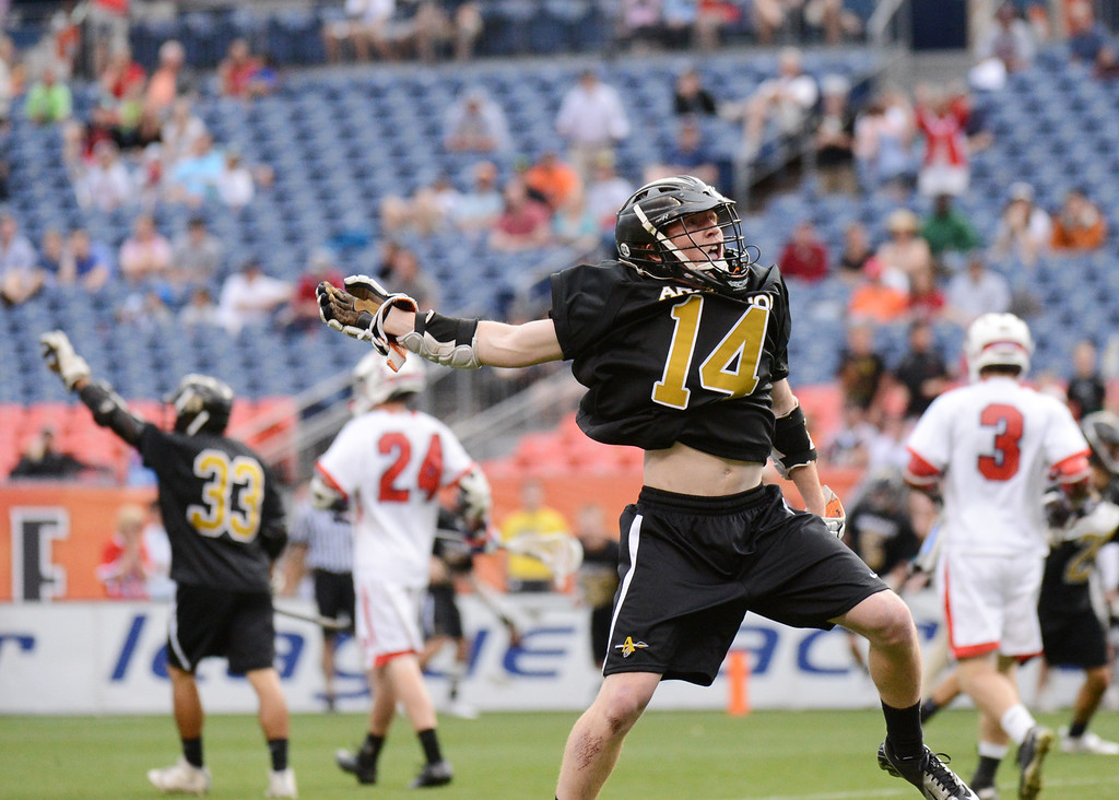. DENVER, CO. - MAY 18 : J.D. Hall of Arapahoe High School (14) celebrates winning 5A Boy\'s Lacrosse Championship game against Cherry Creek High School at Sports Authority Field at Mile High Stadium. Denver, Colorado. May 18, 2013. Arapahoe won 10-7. (Photo By Hyoung Chang/The Denver Post)