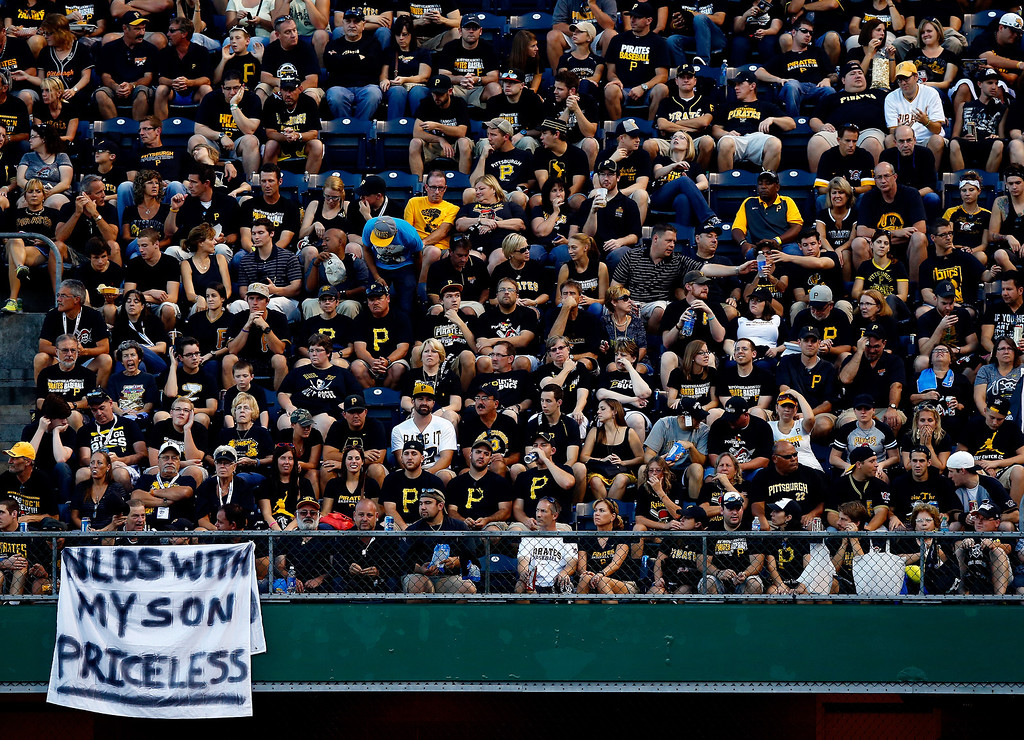 . Fans look on during Game Three of the National League Division Series between the Pittsburgh Pirates and the St. Louis Cardinals at PNC Park on October 6, 2013 in Pittsburgh, Pennsylvania.  (Photo by Jared Wickerham/Getty Images)