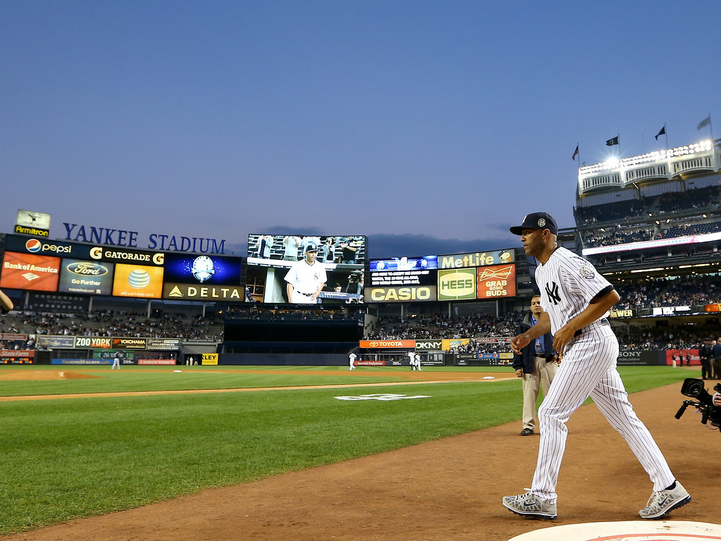 . NEW YORK, NY - SEPTEMBER 26:  Mariano Rivera #42 of the New York Yankees walks onto the field before the game against the Tampa Bay Rays on September 26, 2013 at Yankee Stadium in the Bronx borough of New York City. Rivera, Major League Baseball\'s all-time saves leader who is retiring after this season, is appearing in his final game at Yankee Stadium tonight.  (Photo by Elsa/Getty Images)