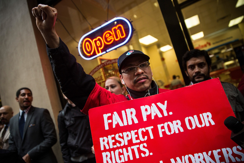 . Protesters demanding higher wages for fast food workers chant during a massive rally outside a Domino\'s Pizza store on May 15, 2014 in New York City.   (Photo by Andrew Burton/Getty Images)