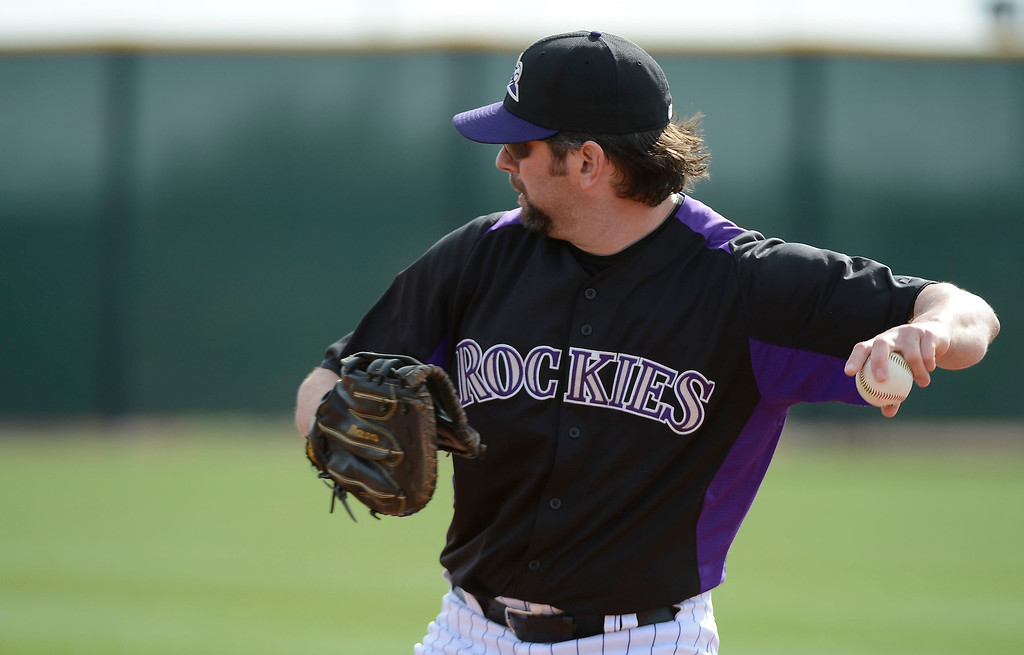 . SCOTTSDALE, AZ. - FEBRUARY 19: Colorado Rockies Todd Helton (17) makes a throw over to second during Spring Training February 19, 2013 in Scottsdale. (Photo By John Leyba/The Denver Post)