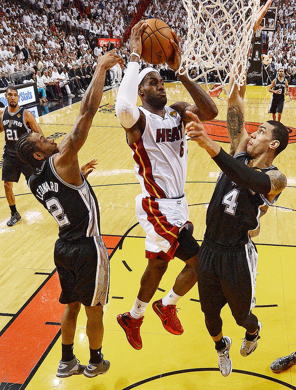 . The Miami Heat\'s LeBron James (6) shoots against San Antonio Spurs\' Kawhi Leonard (2) and Danny Green (4) during the first half in Game 7 of the NBA basketball championships,  Thursday, June 20, 2013, in Miami. (AP Photo/Steve Mitchell, Pool)