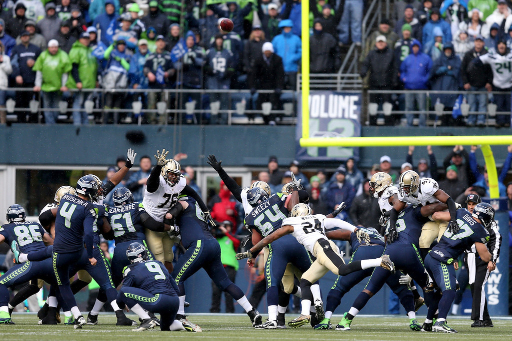 . SEATTLE, WA - JANUARY 11:  Kicker Steven Hauschka #4 of the Seattle Seahawks makes a 38-yard field goal in the first quarter against the New Orleans Saints during the NFC Divisional Playoff Game at CenturyLink Field on January 11, 2014 in Seattle, Washington.  (Photo by Jeff Gross/Getty Images)