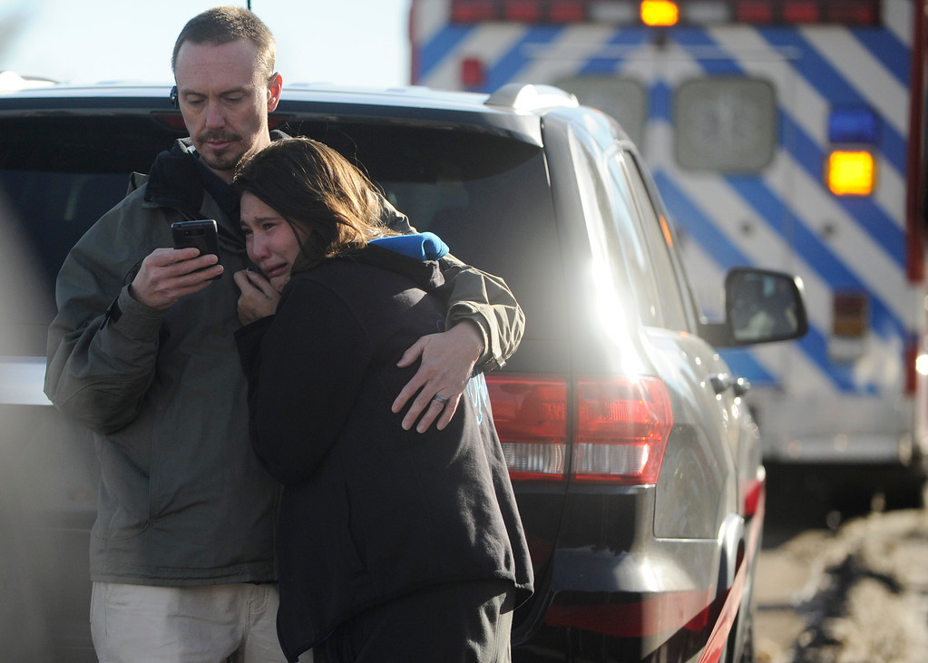 . LITTLETON, CO - DECEMBER 13 : At the school shooting at Arapahoe High School in Littleton, CO  on Friday, December 13, 2013 parent Chris Barrent embraces his tearful daughter Lexi Barrent a senior at the school after they reunited. (Photo By Cyrus McCrimmon/The Denver Post)