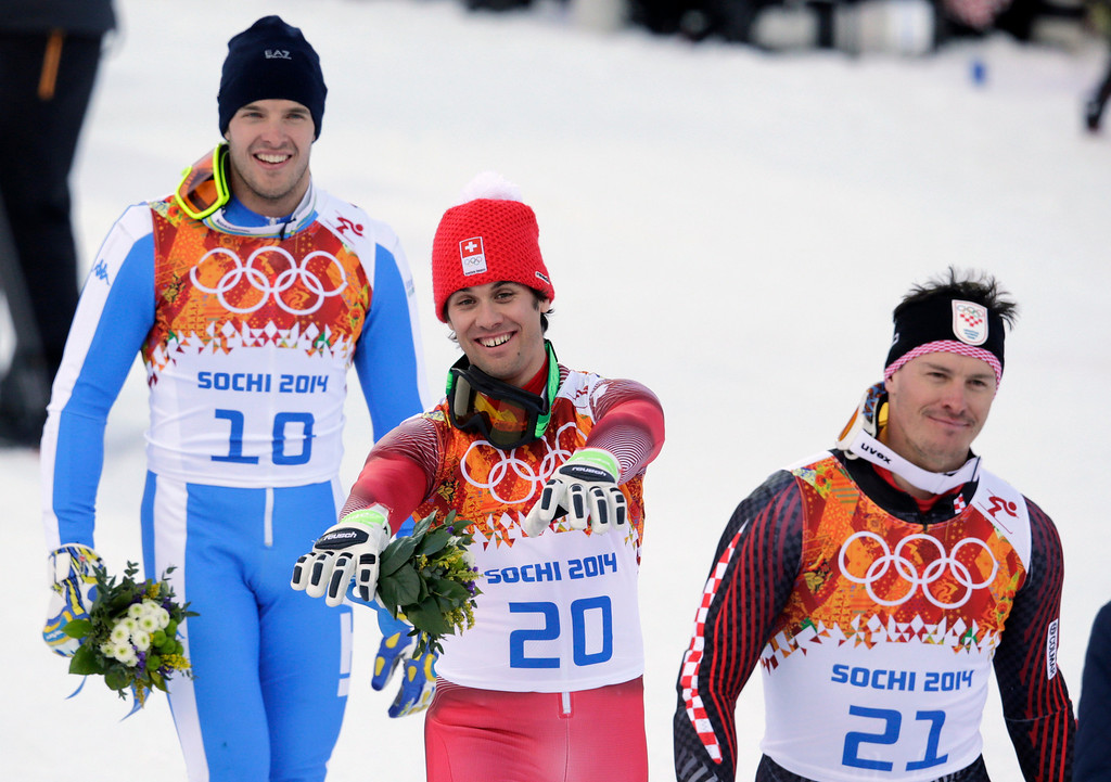 . Men\'s supercombined medalists, from left Italy\'s Christof Innerhofer (bronze), Switzerland\'s Sandro Viletta (gold) and Croatia\'s Ivica Kostelic (silver), leave the podium after a flower ceremony at the Sochi 2014 Winter Olympics, Friday, Feb. 14, 2014, in Krasnaya Polyana, Russia. (AP Photo/Charles Krupa)