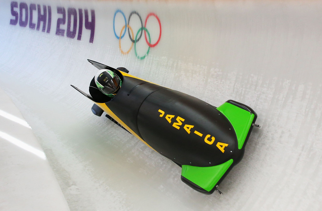 . SOCHI, RUSSIA - FEBRUARY 14:  Winston Watts of Jamaica pilots a run during a Men\'s Two-Man Bobsleigh training session on day 7 of the Sochi 2014 Winter Olympics at the Sanki Sliding Center on February 14, 2014 in Sochi, Russia.  (Photo by Alex Livesey/Getty Images)
