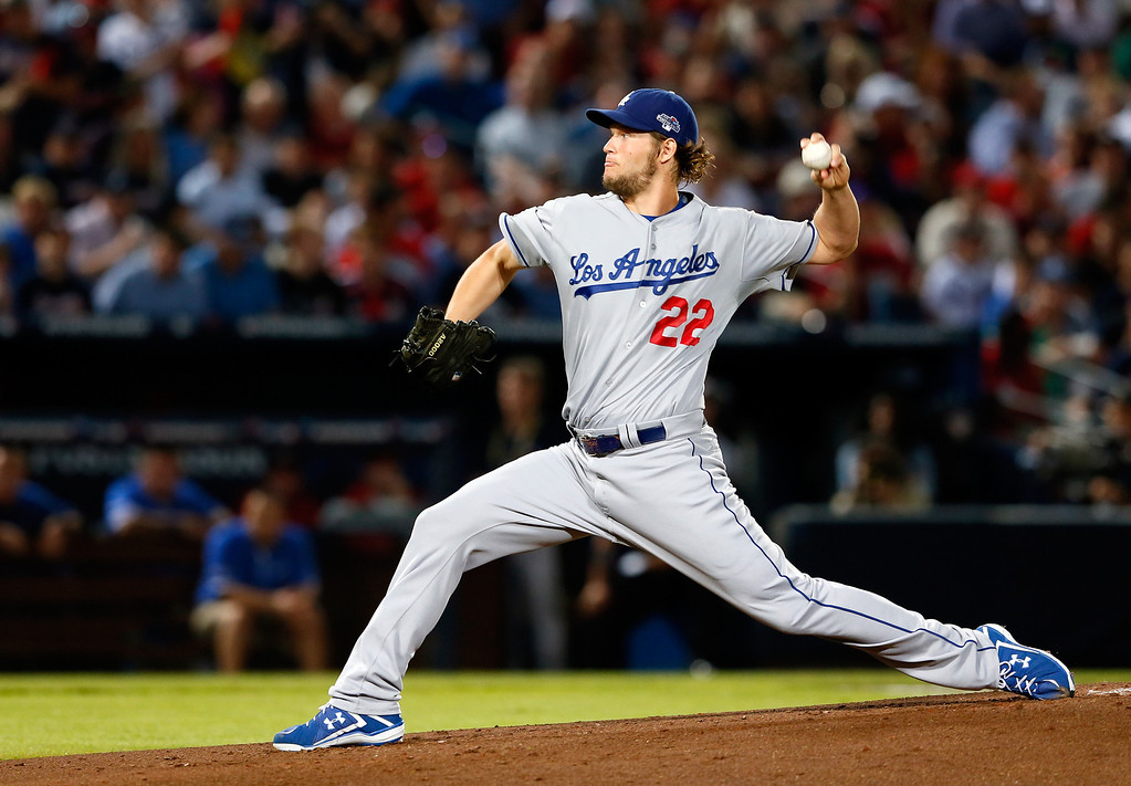 . ATLANTA, GA - OCTOBER 03: Clayton Kershaw #22 of the Los Angeles Dodgers pitches against the Atlanta Braves in the first inning during Game One of the National League Division Series at Turner Field on October 3, 2013 in Atlanta, Georgia.  (Photo by Kevin C. Cox/Getty Images)