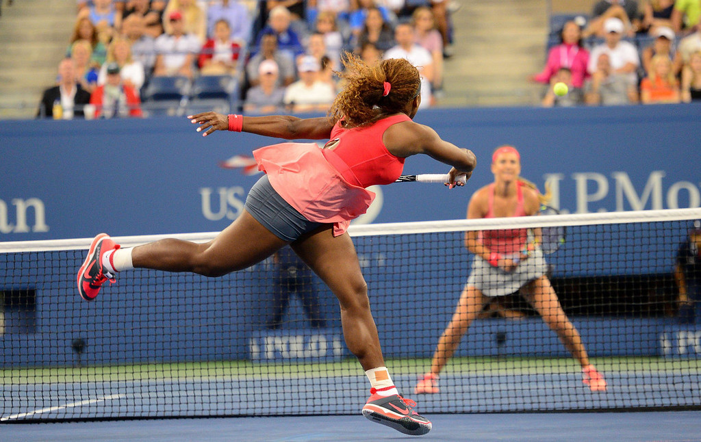 . US tennis player Serena Williams plays a point against Belarus\' Victoria Azarenka during the 2013 US Open women\'s final at the USTA Billie Jean King National Tennis Center in New York on September 8, 2013. EMMANUEL DUNAND/AFP/Getty Images