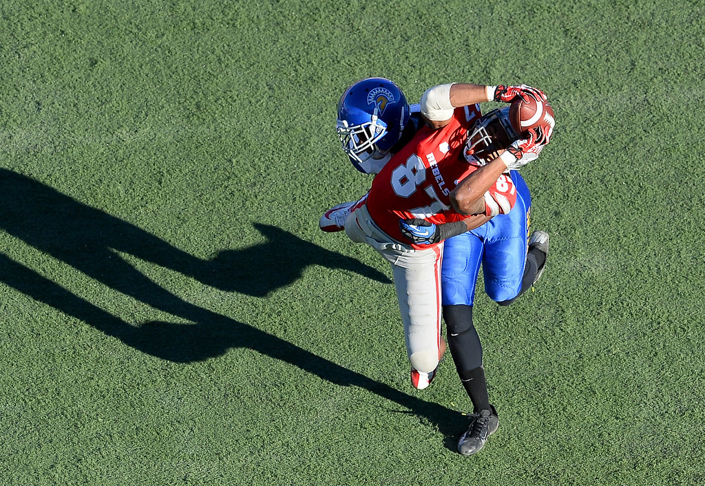 . Maika Mataele #87 of the UNLV Rebels catches a pass as Jimmy Pruitt #8 of the San Jose State Spartans defends during the fourth quarter of their game at Sam Boyd Stadium on November 2, 2013 in Las Vegas, Nevada. San Jose State won 34-24.  (Photo by Ethan Miller/Getty Images)