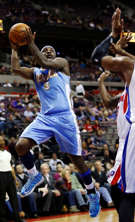 . Denver Nuggets guard Ty Lawson (3) shoots against the Detroit Pistons in the second half of an NBA basketball game, Tuesday, Dec. 11, 2012, in Auburn Hills, Mich. Lawson led all players with 26 points in their 101-94 win. (AP Photo/Duane Burleson)