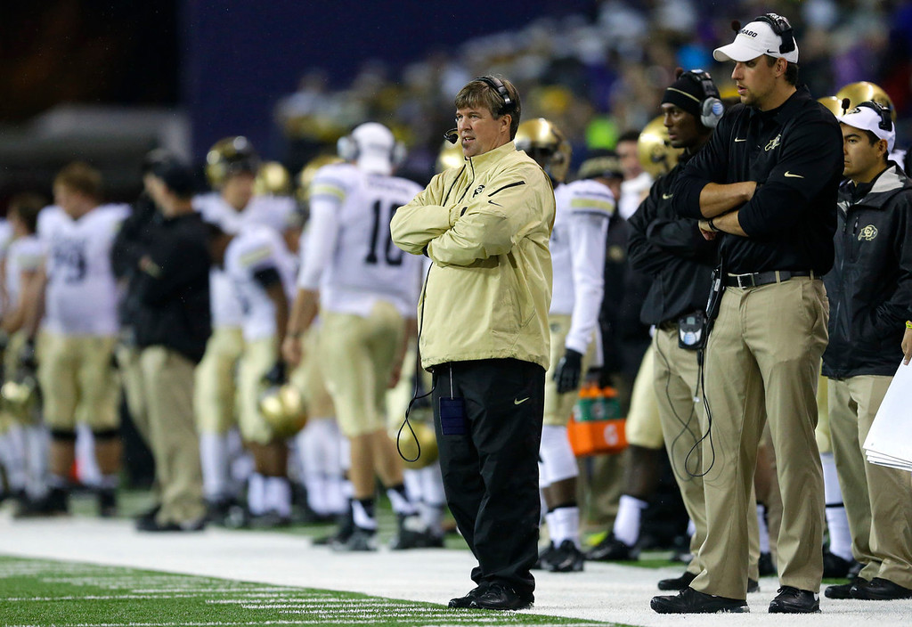 . Colorado head coach Mike MacIntyre, center, watches from the sidelines in the first half of an NCAA college football game against Washington, Saturday, Nov. 9, 2013, in Seattle. (AP Photo/Ted S. Warren)