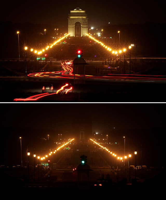 . In this two photo combination picture, the landmark India Gate is seen lit, top, and then the same location in darkness when the lights are turned out for one hour to mark Earth Hour, in New Delhi, India, Saturday, March 23, 2013. Earth Hour was marked worldwide at 8.30 p.m. local time and is a global call to turn off lights for 60 minutes in a bid to highlight the global climate change. (AP Photo/Altaf Qadri)