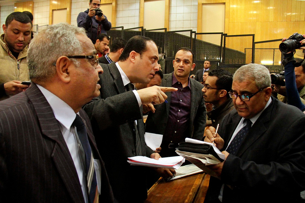 . Lawyers for defendants confer after the Port Said Criminal Court, holding its hearing in Cairo for security reasons, ruled in the case of last year\'s soccer violence in Port Said which left over 70 dead, in Cairo, Egypt, Saturday, March 9, 2013.  (AP Photo/Ahmed Abd El Latef, El Shorouk Newspaper)