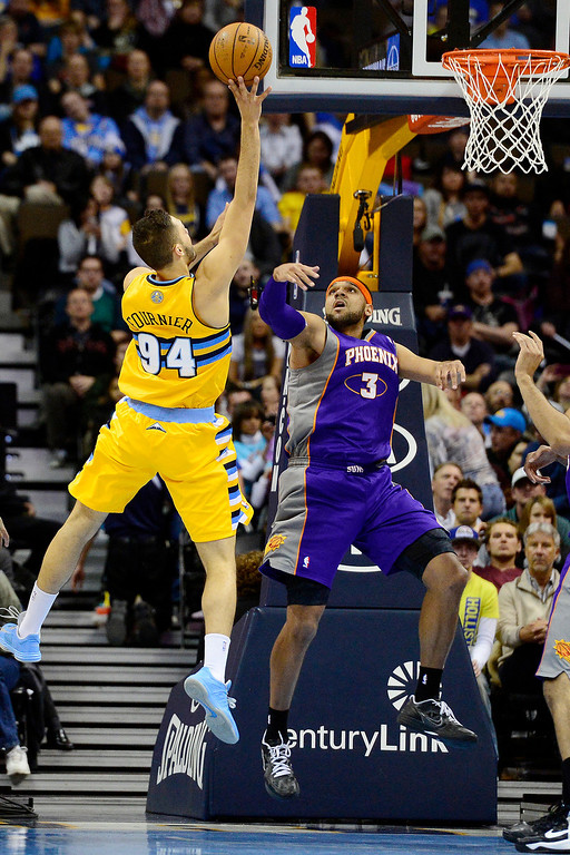 . Jared Dudley (3) of the Phoenix Suns defends Evan Fournier (94) of the Denver Nuggets during the first half of action. The Denver Nuggets play the New York Knicks at the Pepsi Center. (Photo by AAron Ontiveroz/The Denver Post)