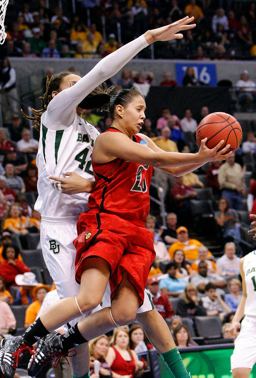 . Louisville guard Shoni Schimmel (23) takes a reverse shot over Baylor\'s Brittney Griner (42) during the second half of a regional semifinal in the women\'s NCAA college basketball tournament in Oklahoma City, Sunday, March 31, 2013.  Louisville won 82-81. (AP Photo/Alonzo Adams)
