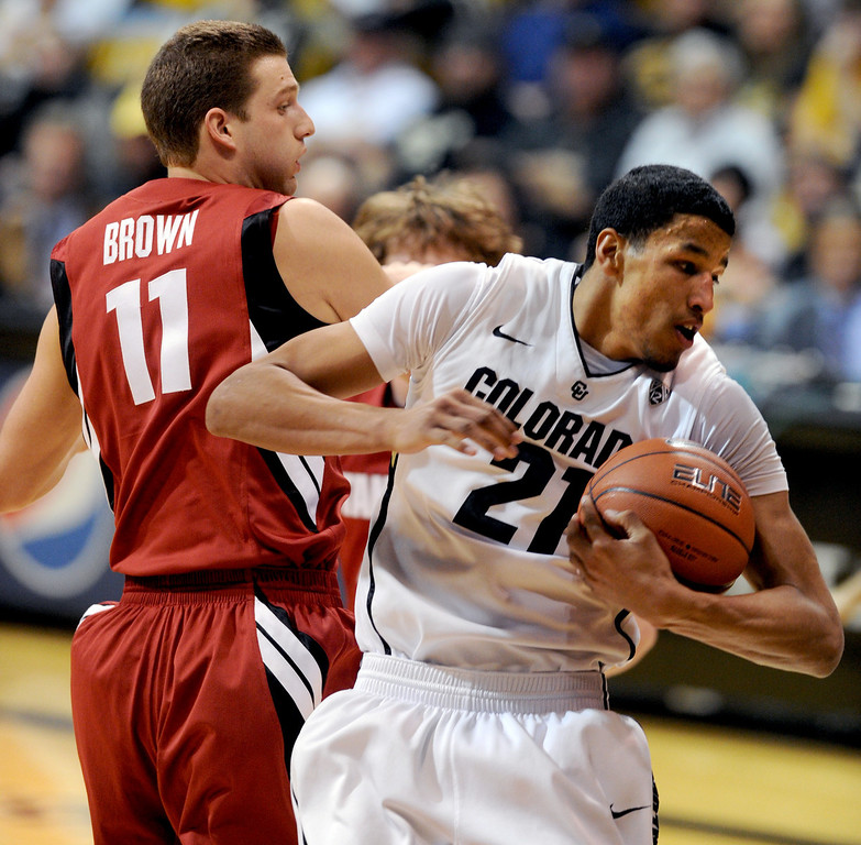 . Andre Roberson of Colorado (21) gets a rebound in front of Andy Brown of Stanford, during the first half of the January 24th, 2013 game in Boulder. For more photos of the game, go to www.dailycamera.com. Cliff Grassmick / January 24, 2013