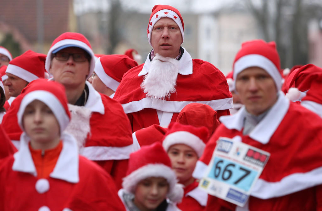 . Participants wait for the start of the 5th annual Michendorf Santa Run (Michendorfer Nikolauslauf) on December 8, 2013 in Michendorf, Germany. Over 900 people took part in this year\'s races, which included one for children and one for adults.  (Photo by Adam Berry/Getty Images)
