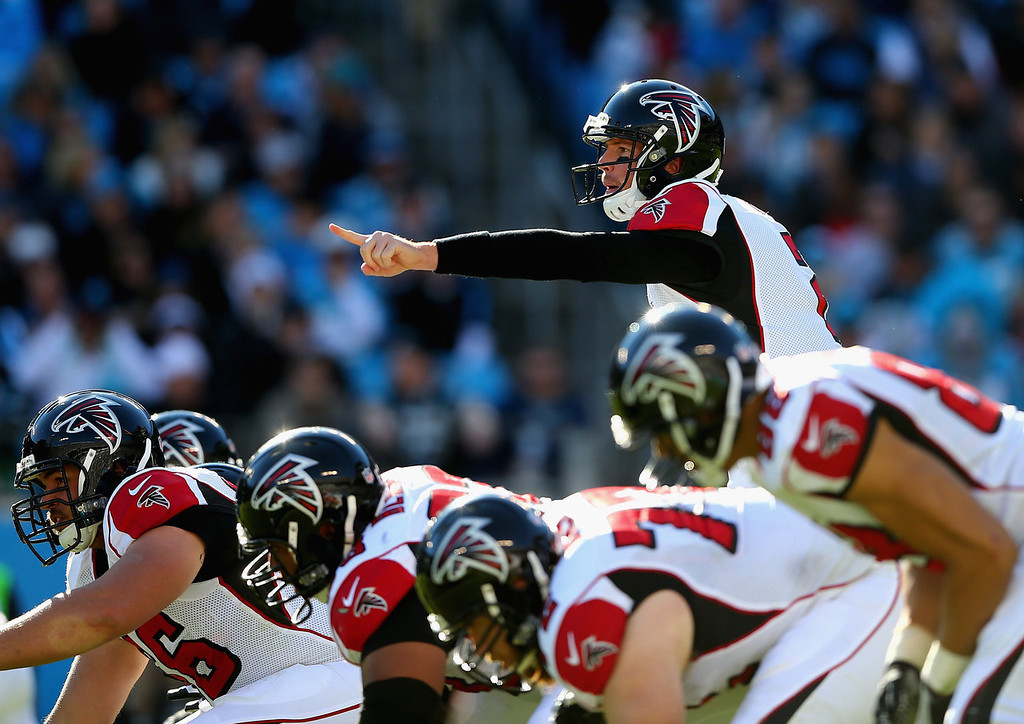 . Matt Ryan #2 of the Atlanta Falcons calls a play against the Carolina Panthers during their game at Bank of America Stadium on November 3, 2013 in Charlotte, North Carolina.  (Photo by Streeter Lecka/Getty Images)