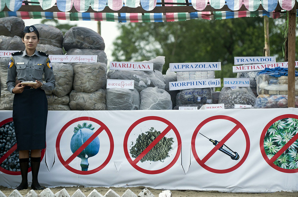 . A policewoman stands beside seized drugs during a destruction ceremony marking the UN\'s international day against drug abuse and illicit trafficking in Yangon on June 26, 2013.  Authorities burned drugs seized across Myanmar, a renowned hub for production, transit and consumption of illicit substances.  Ye Aung Thu/AFP/Getty Images
