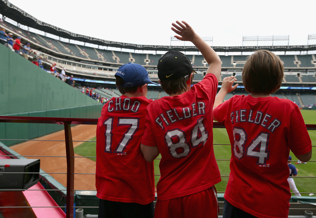 . Fans watch batting practice before the MLB Opening Day game between the Philadelphia Phillies and the Texas Rangers at Globe Life Park in Arlington on March 31, 2014 in Arlington, Texas.  (Photo by Ronald Martinez/Getty Images)