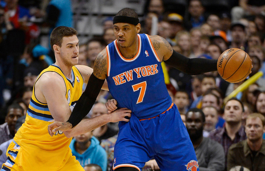 . Carmelo Anthony (7) of the New York Knicks works against Danilo Gallinari (8) of the Denver Nuggets during the first quarter March 13, 2013 at Pepsi Center. (Photo By John Leyba/The Denver Post)