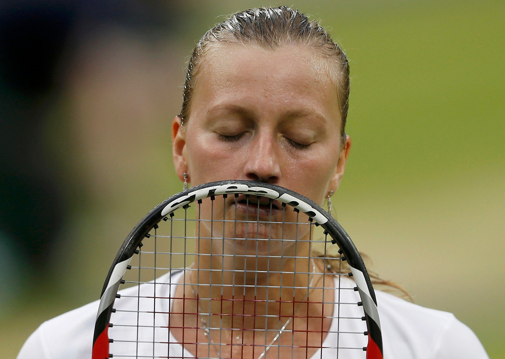 . Petra Kvitova of the Czech Republic reacts during her women\'s quarter-final tennis match against Kirsten Flipkens of Belgium at the Wimbledon Tennis Championships, in London July 2, 2013.     REUTERS/Eddie Keogh