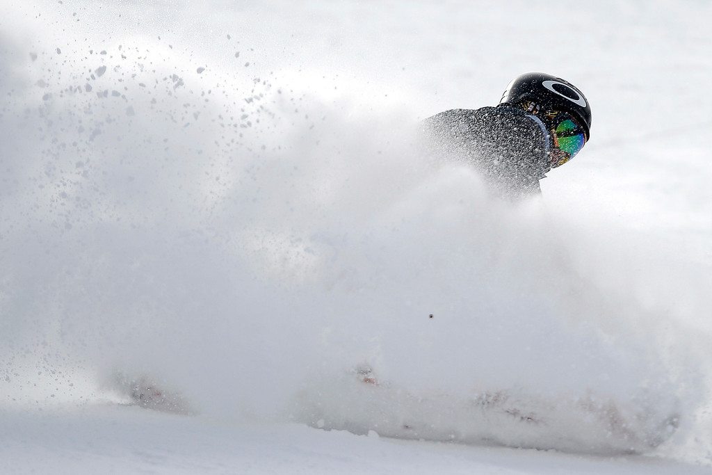 . Champion Staale Sandbech pumps his fist after his title run during the slopestyle finals of the Copper Mountain Grand Prix.   (Photo by AAron Ontiveroz/The Denver Post)