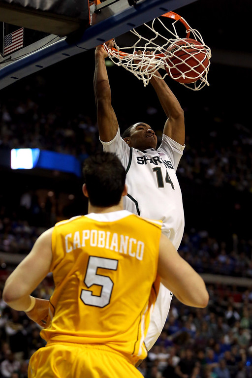. Keith Appling #11 of the Michigan State Spartans dunks in the second half against Bobby Capobianco #5 of the Valparaiso Crusaders during the second round of the 2013 NCAA Men\'s Basketball Tournament at at The Palace of Auburn Hills on March 21, 2013 in Auburn Hills, Michigan.  (Photo by Jonathan Daniel/Getty Images)