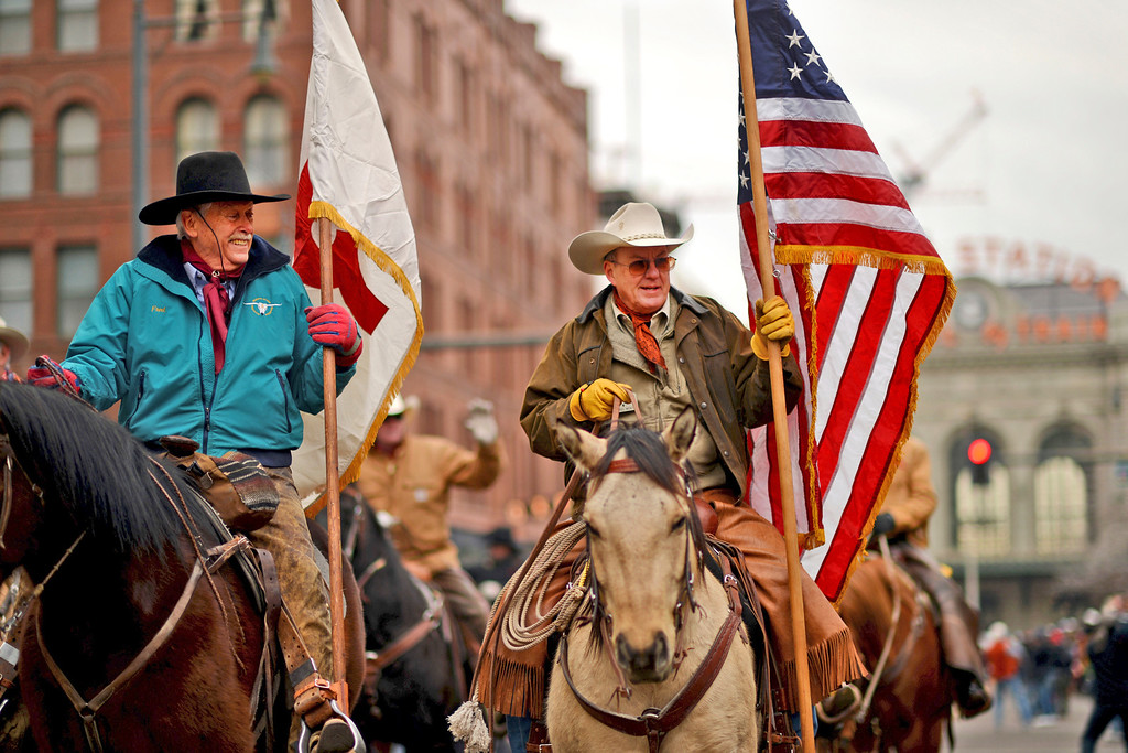 . Darrel Wentz, right, and others celebrate 107th National Western Stock Show Kick-Off Parade at Downtown Denver on Thursday, Denver. CO, January 10, 2013.  Hyoung Chang, The Denver Post