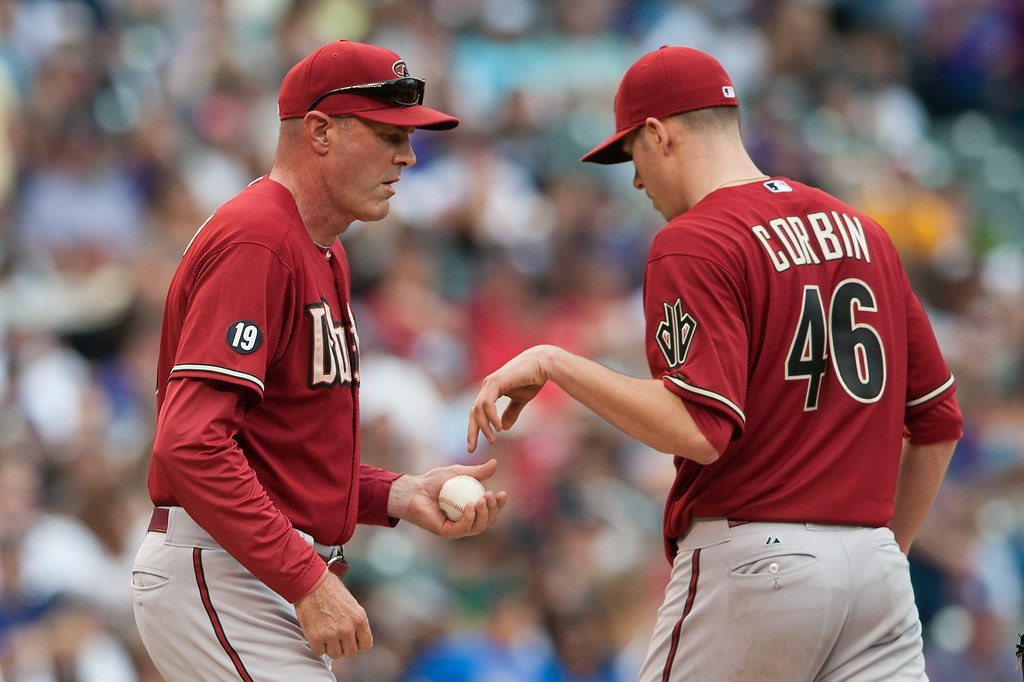 . Manager Kirk Gibson #23 comes to the mound to relieve Patrick Corbin #46 of the Arizona Diamondbacks in the fifth inning of a game against the Colorado Rockies at Coors Field on September 22, 2013 in Denver, Colorado.  (Photo by Dustin Bradford/Getty Images)