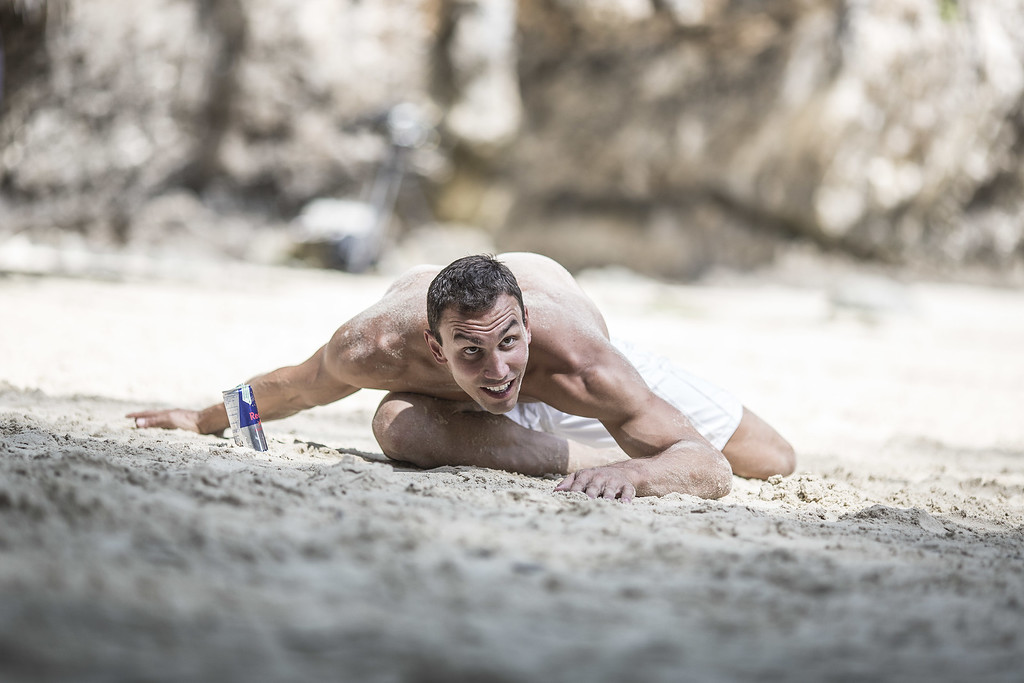 . In this handout image provided by Red Bull, Michal Navratil of the Czech Republic stretches before training on Hong Island in the Andaman Sea during the final stop of the 2013 Red Bull Cliff Diving World Series on October 25, 2013 at Krabi, Thailand. (Photo by Dean Treml/Red Bull via Getty Images)