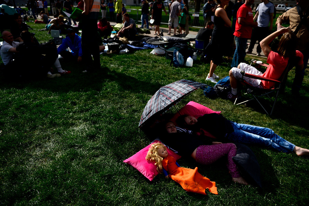 . Sisters Rainy, 11, and Violet, 9, Summers lie with their doll as their parents prepare before the tryout for American Ninja Warrior Denver on on May 19, 2013. (Photo by AAron Ontiveroz/The Denver Post)