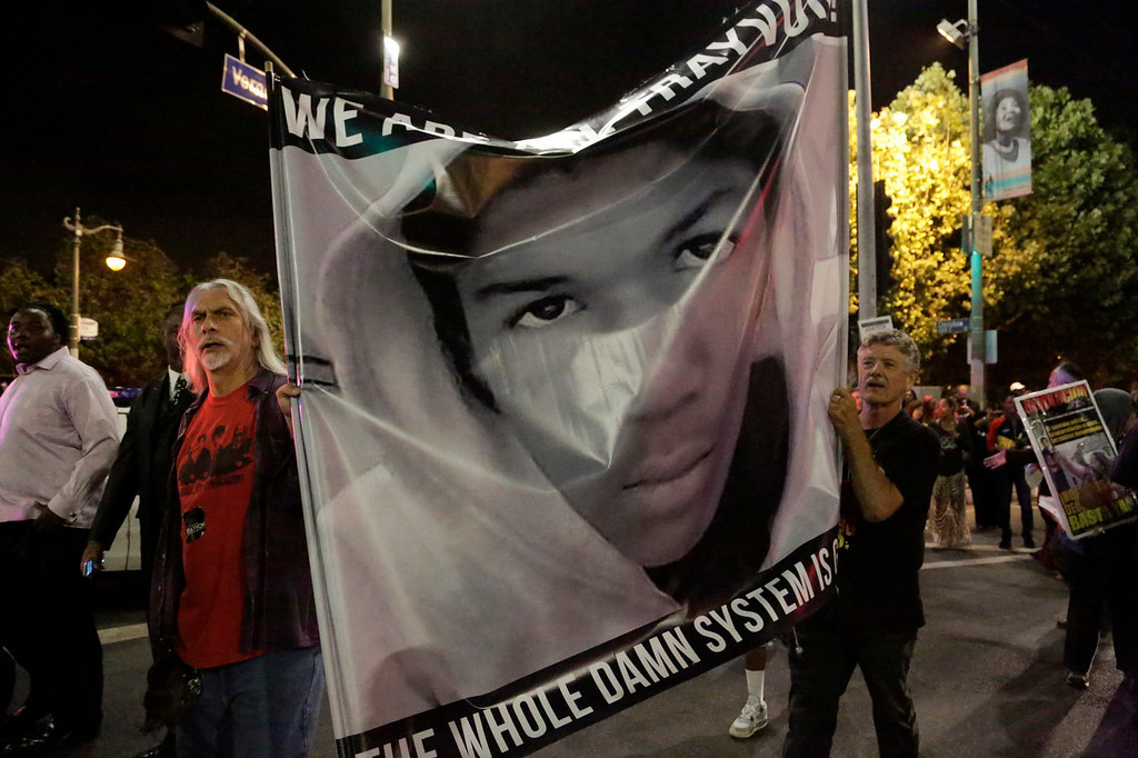 . Protesters hold an image of Trayvon Martin while marching in the Leimert Park area of Los Angeles, California, following the George Zimmerman verdict, July 13, 2013. A Florida jury acquitted Zimmerman on Saturday for the shooting death of unarmed black teenager Martin, setting free a man who had become a polarizing figure in the national debate over racial profiling and self-defense laws. REUTERS/Jason Redmond