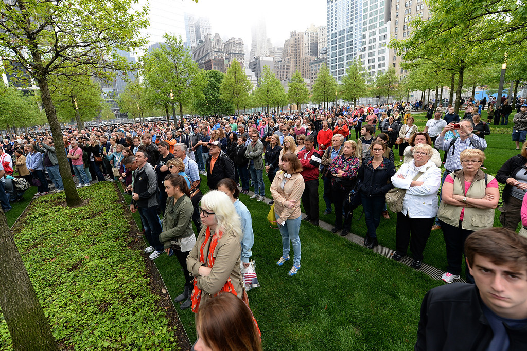 . Members of the general public watch a screen projection on the World Trade Center Plaza during the dedication ceremony at the National September 11 Memorial Museum in New York on Thursday,  May 15, 2014. (AP Photo/ Anthony Behar, Pool)