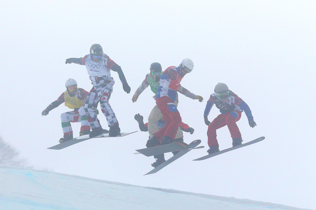 . Pierre Vaultier of France (red bib), Luca Matteotti of Italy (yellow bib), Nikolay Olyunin of Russia (white bib), Alex Deibold of the United States (green bib) and Paul-Henri De Le Rue of France (black bib) compete in the Men\'s Snowboard Cross Big Final on day eleven of the 2014 Winter Olympics at Rosa Khutor Extreme Park on February 18, 2014 in Sochi, Russia.  (Photo by Cameron Spencer/Getty Images)