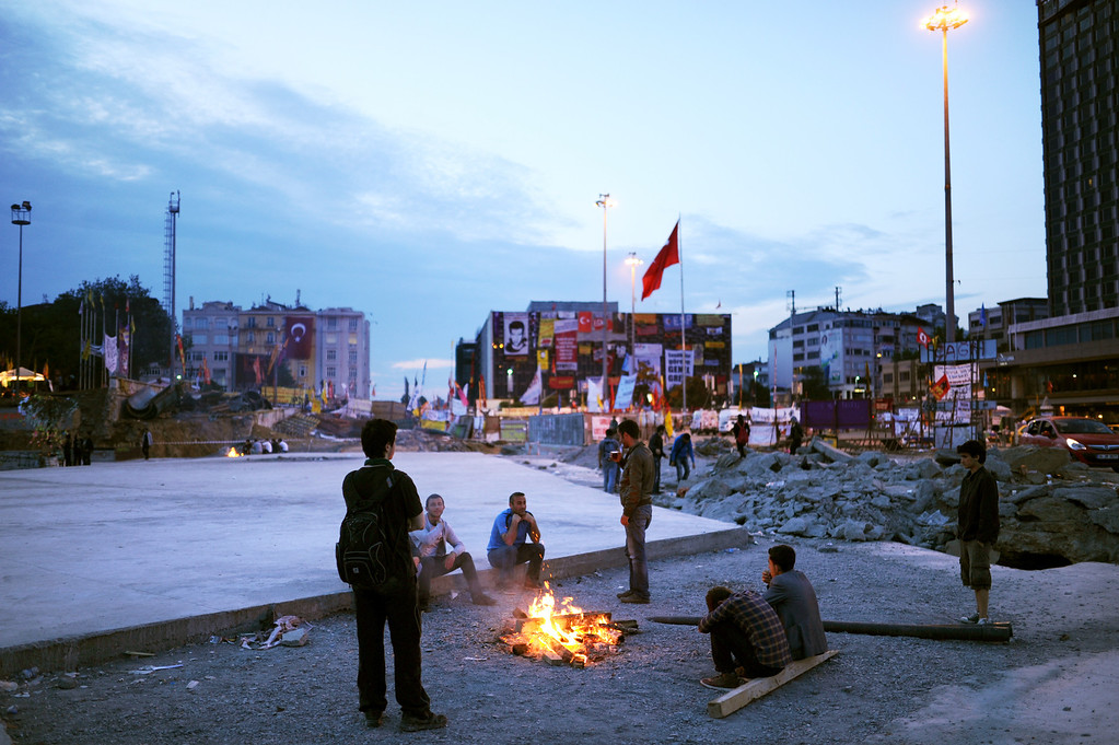 . Protesters gather around a fire early on June 6, 2013 in Taksim, Istanbul. Prime Minister Recep Tayyip Erdogan was due back in Turkey Thursday after a trip abroad, with thousands of angry demonstrators calling for his resignation as protests entered a seventh day.  BULENT KILIC/AFP/Getty Images