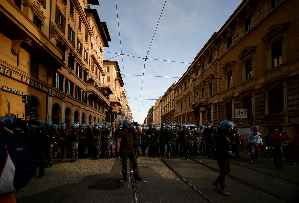 . Anti-riot policemen block a street on the sidelines of an anti-austerity protest on October 19, 2013 in Rome. Between 3,000 and 4,000 police officers have been deployed, Italian media reports said, and protest organizers say they expect more than 20,000 to join.  FILIPPO MONTEFORTE/AFP/Getty Images