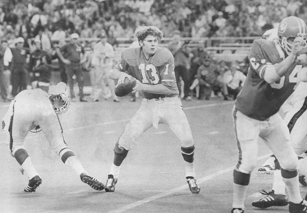 . Broncos\' Don Horn prepares to pass after blitzing Steve Zabel from Thornton, Colo., Pilters his helmet another Eagle forced Horn to fumble the ball into the air and Mike Schnitker (right) recovered for Denver for an 11-yard loss to its 24. 1971.   (Photo by David Cupp/Denver Post)