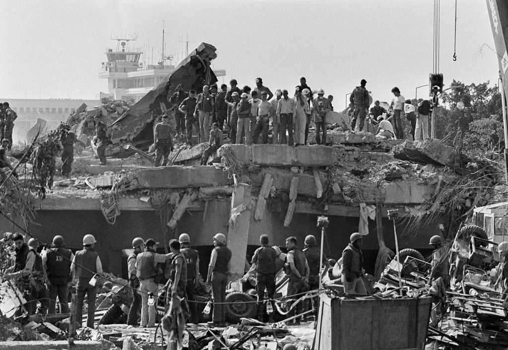 . In this Monday, Oct. 24,1983 file photo, rescuers continue to probe the wreckage of the U.S. Marine barracks a day after a suicide truck bomb near Beirut airport, Lebanon. In the background can be seen the control tower of the Beirut airport. The blast _ the single deadliest attack on U.S. forces abroad since World War II _ claimed the lives of 241 American service members. (AP Photo/Zouki, File)