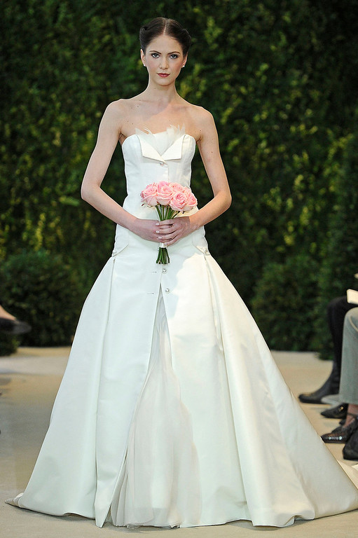 . In this photo released by Carolina Herrera Designer, a model presents a bridal fashion creation from the Carolina Herrera collection, in New York, Sunday, April 21, 2013. (AP Photo/Carolina Herrera)