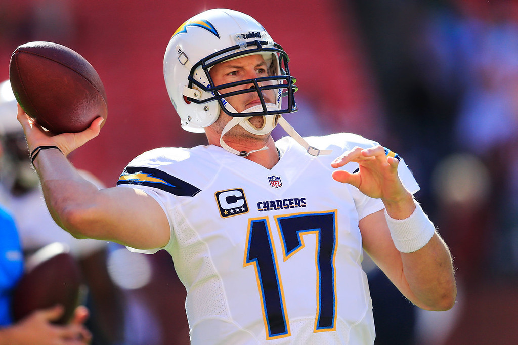 . Quarterback Philip Rivers #17 of the San Diego Chargers throws a pass while warming up before the start of the Chargers game against the Washington Redskins  at FedExField on November 3, 2013 in Landover, Maryland. (Photo by Rob Carr/Getty Images)